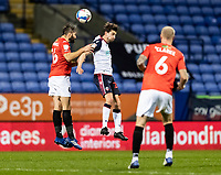 Bolton Wanderers' Shaun Miller competing with Salford City's Jordan Turnbull (left) <br /> <br /> Photographer Andrew Kearns/CameraSport<br /> <br /> The EFL Sky Bet League Two - Bolton Wanderers v Salford City - Friday 13th November 2020 - University of Bolton Stadium - Bolton<br /> <br /> World Copyright © 2020 CameraSport. All rights reserved. 43 Linden Ave. Countesthorpe. Leicester. England. LE8 5PG - Tel: +44 (0) 116 277 4147 - admin@camerasport.com - www.camerasport.com