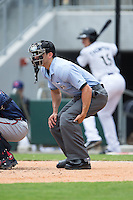 Home plate umpire Derek Mollica during the International League game between the Gwinnett Braves and the Charlotte Knights at BB&T BallPark on July 3, 2015 in Charlotte, North Carolina.  The Braves defeated the Knights 11-4 in game one of a day-night double header.  (Brian Westerholt/Four Seam Images)