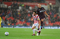 Joe Allen of Stoke City battles with Mike van der Hoorn of Swansea City during the Sky Bet Championship match between Stoke City and Swansea City at the Bet 365 Stadium in Stoke on Trent, England, UK. Tuesday 18 September 2018