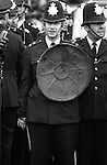 Notting hill Gate Carnival race riot, London W11 England 1976. Police use dustbin lids as shields.
