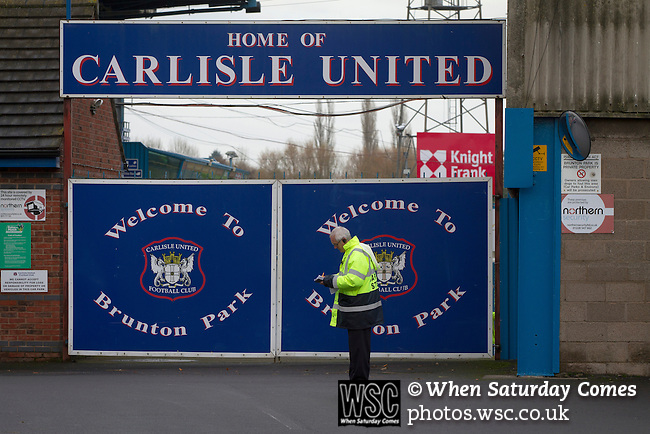 Carlisle United 1 Accrington Stanley 0, 15/11/2014. Brunton Park, League Two. A steward checking details outside the stadium prior to the English League Two match between Carlisle United and visitors Accrington Stanley at Brunton Park. The match was won by the home team by one goal to nil, the winner scored by Derek Asamoah in the 21st minute. The match was watched by 4,069 spectators. Photo by Colin McPherson.