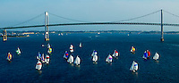 A typical Wednesday night scene in the summer: The Newport Shields Fleet of one-design sailboats racing on Narragansett Bay.