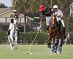 WELLINGTON, FL - APRIL 15:  Agustin Obregon of Palm Beach Illustrated (dark jersey) controls the ball along the sideline as teammate Tommy Collingwood backs up the play in the $100,000 World Cup Final, at the Grand Champions Polo Club, on April 15, 2017 in Wellington, Florida. (Photo by Liz Lamont/Eclipse Sportswire/Getty Images)