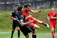 Ben Mata of Team Wellington competes for the ball with Ihaia Delaney of Canterbury United during the ISPS Handa Men's Premiership - Team Wellington v Canterbury Utd at David Farrington Park, Wellington on Saturday 19 December 2020.<br /> Copyright photo: Masanori Udagawa /  www.photosport.nz