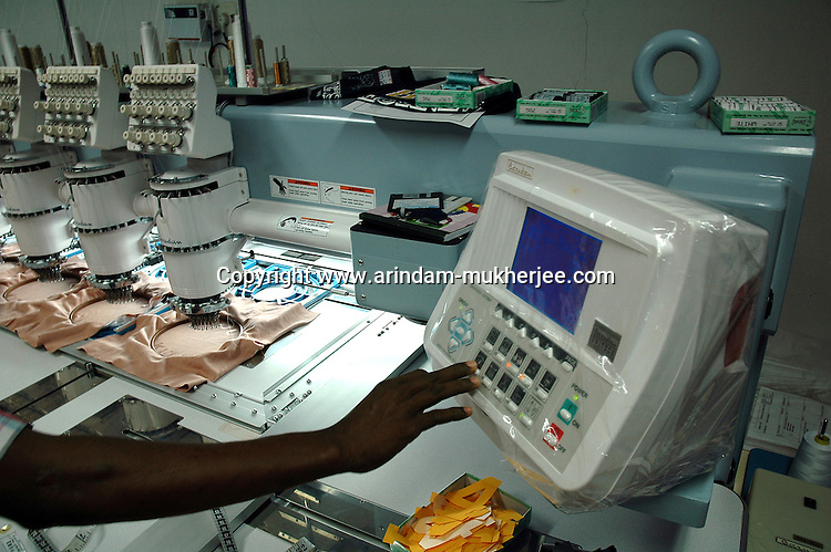 Embroidery Unit of Prime Tex Industry. Indian workers are trained to operate sophisticated machines for garment manufacturing in Tirupur, Tamilnadu. After lifting of quota system in textile export on 1st january 2005. Tirupur has become the biggest foreign currency earning town of India.