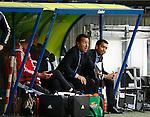 Nederland, Heerenveen, 21 mei 2015<br /> Seizoen 2014-2015<br /> SC Heerenveen-Feyenoord<br /> Giovanni van Bronckhorst bij zijn debuut als trainer van Feyenoord. Hij baalt van het doelpunt van SC Heerenveen. Links Jean Paul van Gastel