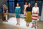 Fashion designer Austyn Zung poses with  models during the Ann Taylor Spring Summer 2017 collection fashion presentation, at the Ann Taylor showroom in 7 Times Square, New York on October 26, 2016.