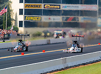 Sep 16, 2018; Mohnton, PA, USA; NHRA top fuel driver Clay Millican (left) alongside Steve Torrence during the Dodge Nationals at Maple Grove Raceway. Mandatory Credit: Mark J. Rebilas-USA TODAY Sports