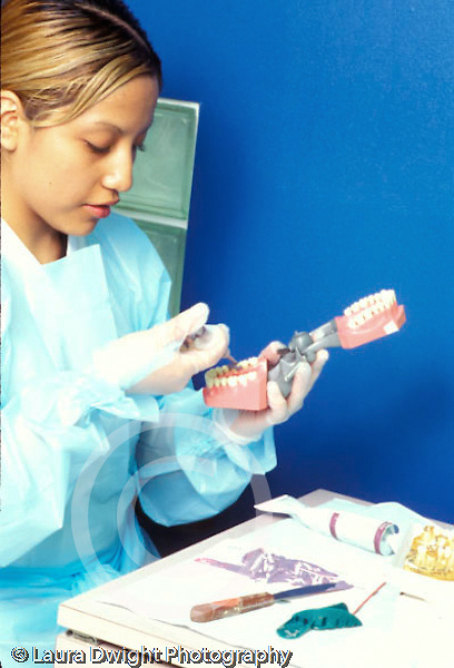 Teenagers in workplace Dental assistant student working on tooth mold