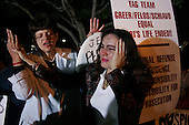 Pinellas Park, Florida.USA.March 25, 2005..Protesters begin to cry outside the Woodside Hospice as Terri Schiavo's health wanes and a federal judge refused to order the reinsertion of her feeding tube, thwarting another legal move from the brain-damaged woman's parents. Schiavo's feeding tube was removed by court order on March 18, 2005.