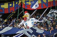 BOGOTA - COLOMBIA -19 – 08 - 2015: Hinchas de Millonarios animan a su equipo durante partido entre Millonarios y Deportivo Cali por la fecha 7 de la Liga Aguila II 2015, jugado en el estadio Nemesio Camacho El Campin de la ciudad de Bogota. / Fans of Millonarios cheer their team during a match Millonarios and Deportivo Cali for date 7 of the Liga Aguila II 2015 at the Nemesio Camacho El Campin Stadium in Bogota city. Photo: VizzorImage  / Luis Ramirez / Staff.