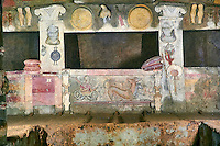 Interior of the Tomb of Reliefs that has everyday Etruscan objects carved into the volcanc Tuff rock, as well as separate burial chambers with rock pillows, the freeze below the burial niche depicts the gods of the underworld, Scilla and her three headed dog cerberus, 4th century BC, Necropoli della Banditaccia, Cerveteri, Italy. A UNESCO World Heritage Site