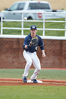 Wingate Bulldogs first baseman Mitch Farris (15) waits for a throw during the game against the Concord Mountain Lions at Ron Christopher Stadium on February 1, 2020 in Wingate, North Carolina. The Bulldogs defeated the Mountain Lions 8-0 in game one of a doubleheader. (Brian Westerholt/Four Seam Images)