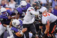 TCU defensive end Mike Tuaua (93) sacks Oklahoma State quarterback Daxx Garman (12) during second half of an NCAA football game, Saturday, October 18, 2014 in Fort Worth, Tex. TCU defeated Oklahoma State 42-9. (Mo Khursheed/TFV Media via AP Images)