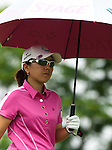 CHON BURI, THAILAND - FEBRUARY 17:  Mika Miyazato of Japan shelters from the sun under an umbrella during day two of the LPGA Thailand at Siam Country Club on February 17, 2012 in Chon Buri, Thailand.  Photo by Victor Fraile / The Power of Sport Images