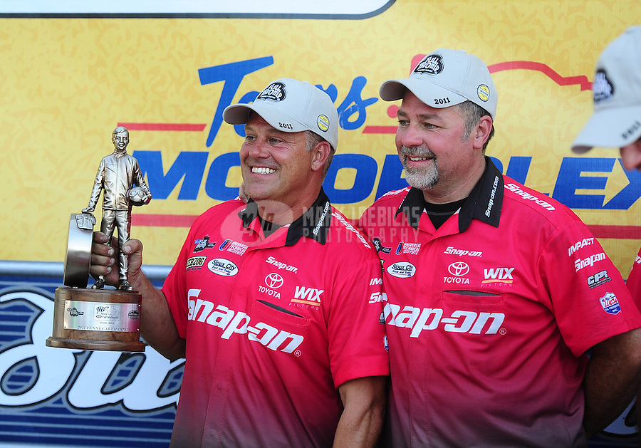 Sept. 25, 2011; Ennis, TX, USA: Crew members for NHRA funny car driver Cruz Pedregon celebrate after winning the Fall Nationals at the Texas Motorplex. Mandatory Credit: Mark J. Rebilas-