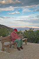 Man on bench with laptop. Great Basin National Park, Nevada