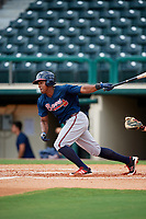 Atlanta Braves Braulio Vasquez (14) hits an infield single during a Florida Instructional League game against the Canadian Junior National Team on October 9, 2018 at the ESPN Wide World of Sports Complex in Orlando, Florida.  (Mike Janes/Four Seam Images)