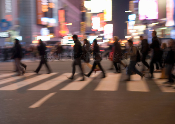 AVAILABLE FROM GETTY IMAGES FOR COMMERCIAL AND EDITORIAL LICENSING.   Please go to www.gettyimages.com and search for image # 135307804.<br /> <br /> Busy, Blurred Motion Scene of Commuters Crossing Street and Heading Home After Work During the Evening Rush Hour, Times Square and 42nd Street, Midtown Manhattan, New York City, New York State, USA