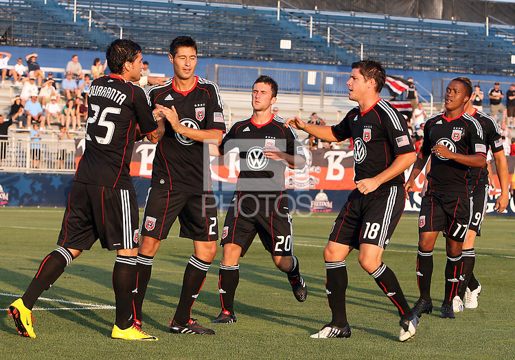 Branko Boskovic #27 of D.C. United is congratulated by teammates after scoring in the first minute during a US Open Cup match against the Harrisburg City Islanders at the Maryland Soccerplex on July 21 2010, in Boyds, Maryland. United won 2-0.