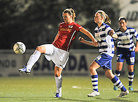 20130906 - OOSTAKKER , BELGIUM : PSV's Lisanne Vermeulen pictured with Gent defender Ine Heemeryck  (right) during the female soccer match between AA Gent Ladies  and PSV / FC Eindhoven Dames , of the third matchday in the BENELEAGUE competition. Friday 06 th September 2013. PHOTO DAVID CATRY