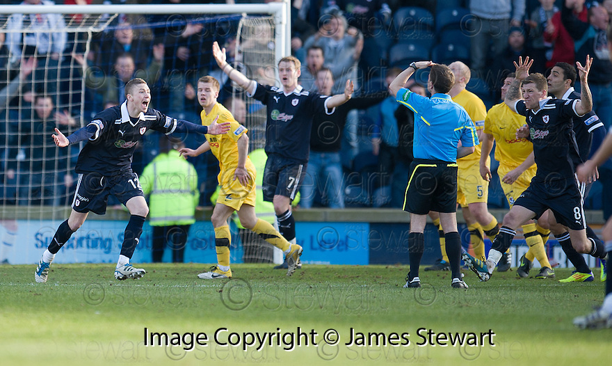 REFEREE CRAWFORD ALLAN IGNORES PLEASE FROM RAITH PLAYERS AFTER PAT CLARKES SHOT WAS BLOCKED