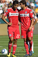 Wiman Conde (l) and teammate Baggio Husidic have a conference before Landon Donovan's PK. The Chicago Fire beat the LA Galaxy 3-2 at Home Depot Center stadium in Carson, California on Sunday August 1, 2010.