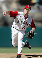 Lou Pote of the Los Angeles Angels pitches during a 2002 MLB season game at Angel Stadium, in Anaheim, California. (Larry Goren/Four Seam Images)