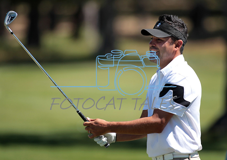 Oscar De La Hoya hits on the driving range before a practice round at the American Century Championship golf tournament at Edgewood Tahoe at Stateline, Nev., on Wednesday, July 18, 2012..Photo by Cathleen Allison