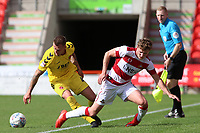Fleetwood Town's Peter Clarke battles with Doncaster Rovers' Brad Halliday<br /> <br /> Photographer David Shipman/CameraSport<br /> <br /> The EFL Sky Bet League One - Doncaster Rovers v Fleetwood Town - Saturday 17th August 2019  - Keepmoat Stadium - Doncaster<br /> <br /> World Copyright © 2019 CameraSport. All rights reserved. 43 Linden Ave. Countesthorpe. Leicester. England. LE8 5PG - Tel: +44 (0) 116 277 4147 - admin@camerasport.com - www.camerasport.com