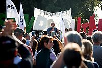 "Rome, 10/10/2020. Today, the Marcia per la Liberazione (March for the liberation) was held in Piazza San Giovanni. People from the No Mask (the mask is now seen as a bavaglio/gag) movement, No-Vax, No-5G, Covid-19 deniers (negazionisti), conspiracy theorists, supporters of the ""Metodo Di Bella"", No-Euro, No-European Union, populists (populisti), souverainists (sovranisti), Liberiamo l'Italia, Trump supporters, far-rights political movements gathered in Piazza San Giovanni to hold a rally against the Italian government health policies and restrictions which have been implemented to fight the Coronavirus pandemic SARS-CoV-2 infection COVID-19, described by protesters as ""health dictatorship"".<br />