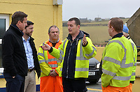 Pictured: Prime Minister David Cameron (L) speaks to Pembrokeshire Council workers who have been working to rectify the damage caused in Newgale, Pembrokeshire. Wednesday 19 February 2014<br />