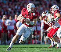 PASADENA, CA - January 1, 2013: Stanford quarterback Kevin Hogan (8) rolls out to pass during the Stanford Cardinal vs the Wisconsin Badgers game in the 2013 Rose Bowl Game in Pasadena, California. Final score Stanford 20, Wisconsin 14.