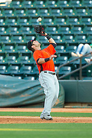 Frederick Keys first baseman Christian Walker (19) catches a pop fly during the Carolina League game against the Winston-Salem Dash at BB&T Ballpark on May 28, 2013 in Winston-Salem, North Carolina.  The Dash defeated the Keys 17-5 in the first game of a double-header.  (Brian Westerholt/Four Seam Images)