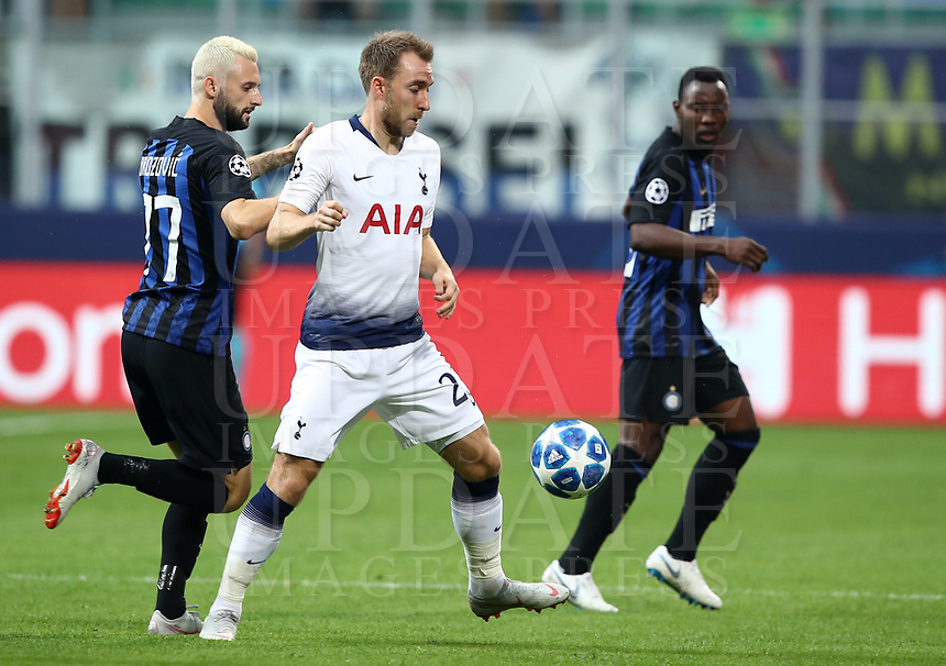 Football Soccer: UEFA Champions League FC Internazionale Milano vs Tottenham Hotspur FC, Giuseppe Meazza stadium, September 15, 2018.<br /> Tottenham's Christian Eriksen (c) in action with Inter's Marcelo Brozovic (l) during the Uefa Champions League football match between Internazionale Milano and Tottenham Hotspur at Giuseppe Meazza (San Siro) stadium, September 18, 2018.<br /> UPDATE IMAGES PRESS/Isabella Bonotto