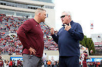 BLACKSBURG, VA - OCTOBER 19: Head coach Justin Fuente of Virginia Tech listens to head coach Mack Brown of the University of North Carolina during a game between North Carolina and Virginia Tech at Lane Stadium on October 19, 2019 in Blacksburg, Virginia.