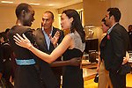 Model Ajak Deng (left) talking with photographer Nigel Barker and his wife Cristen Barker, during the Pamella Roland Resort 2017 collection fashion presentation at Bvlgari located at 4 West 57 Street in New York City, on June 8, 2018.
