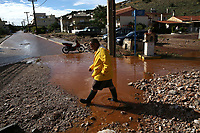 Pictured: People walk in a flooded road in the Magoula area, in the outskirts of Athens, Greece. Wednesday 27 June 2018<br /> Re: Flashflooding has been caused by storm Nefeli in parts of Greece.