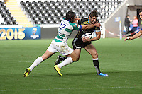 Sunday 19 October 2014<br /> Pictured:Ospreys centre Andrew Bishop takes on Enrico Bacchin.<br /> <br /> Re: Ospreys v Treviso, Heineken Champions Cup at the Liberty Stadium, Swansea