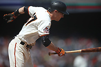 SAN FRANCISCO, CA - MAY 16:  Kelby Tomlinson #37 of the San Francisco Giants bats against the Cincinnati Reds during the game at AT&T Park on Wednesday, May 16, 2018 in San Francisco, California. (Photo by Brad Mangin)