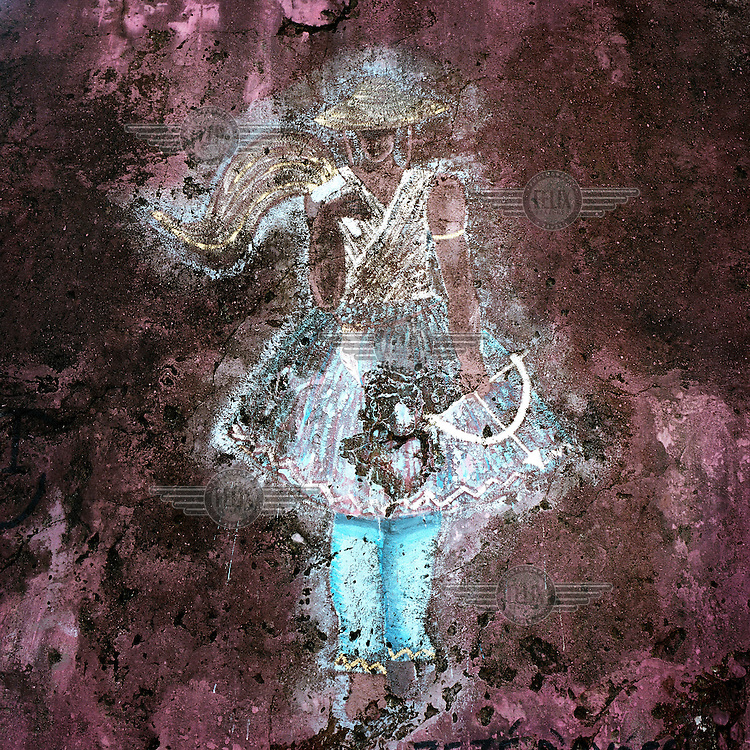 A faded mural of Oxissa - the god (orixa) of the hunters in the Candomble religion.