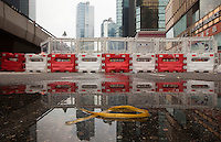 A yellow ribbon symbolising democracy is seen in a puddle by a barricade on day three of the mass civil disobedience campaign Occupy Central, Hong Kong, China, 30 September 2014.