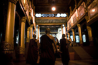 Monks approach the east gate of the Shwedagon Pagoda.