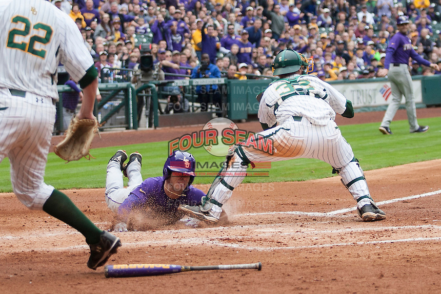 LSU Tigers second baseman Kramer Robertson (3) slides head first at the plate as Baylor Bears catcher Cameron Miller (32) blocks him during the NCAA baseball game on March 7, 2015 in the Houston College Classic at Minute Maid Park in Houston, Texas. LSU defeated Baylor 2-0. (Andrew Woolley/Four Seam Images)