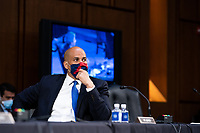 United States Senator Cory Booker (Democrat of New Jersey), listens during a business meeting portion on the fourth day of the confirmation hearing for Judge Amy Coney Barrett, President Donald Trump's Nominee for Supreme Court, in Hart Senate Office Building in Washington DC, on October 15th, 2020.<br /> Credit: Anna Moneymaker / Pool via CNP /MediaPunch