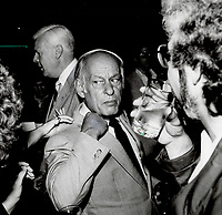 1983 FILE PHOTO - ARCHIVES -<br /> <br /> Collared: Quebec Premier Rene Levesque reacted quickly when he felt a hand on his collar during a reception during the premiers' conference in Toronto last night. What are you doing, he asked sharply as he turned and was relieved to see it was only a guest fixing his coat collar which was askew. Sartorially straightened out, Levesque continued partying.<br /> <br /> 1983<br /> <br /> PHOTO :  Frank Lennon - Toronto Star Archives - AQP