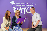 Denise Henderson (C) of Children's Cancer Charity LATCH with Erin McGeough (L) and general manager of Amazon in Swansea Pat Faulkner (R), at the Children's Hospital for Wales in Cardiff, Wales, UK