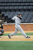 Dillon Dobson (42) of the Appalachian State Mountaineers follows through on his swing against the Wake Forest Demon Deacons at Wake Forest Baseball Park on February 13, 2015 in Winston-Salem, North Carolina.  The Mountaineers defeated the Demon Deacons 10-1.  (Brian Westerholt/Four Seam Images)