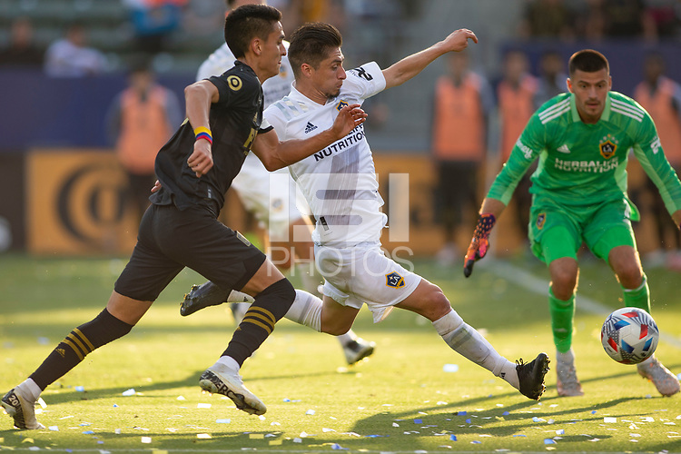 CARSON, CA - MAY 8: Jorge Villafana #19 of the Los Angeles Galaxy moves to clear the ball during a game between Los Angeles FC and Los Angeles Galaxy at Dignity Health Sports Park on May 8, 2021 in Carson, California.
