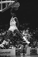 OAKLAND, CA - Terry Teagle of the Golden State Warriors dunks over Darrell Griffith of the Utah Jazz during a game at the Oakland Coliseum Arena in Oakland, California in 1988. Photo by Brad Mangin